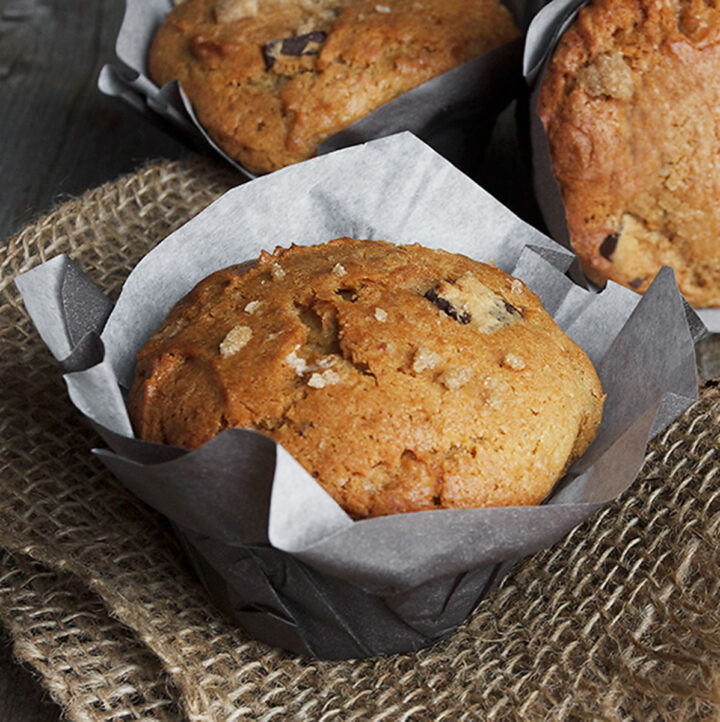 chocolate banana peanut butter muffins in wrappers