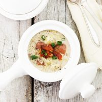 potato and cabbage colcannon soup in white soup pot