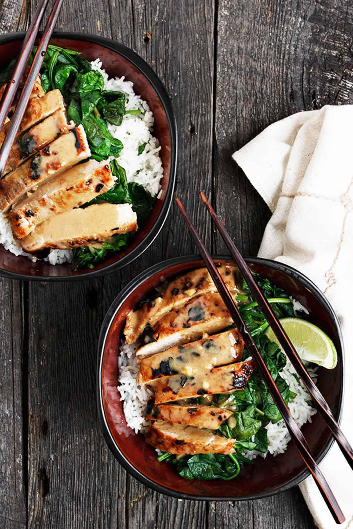Thai pork tenderloin rice bowl in Asian bowl with chopsticks
