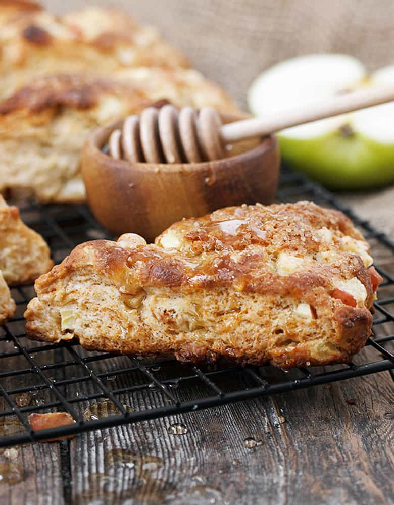 apple buttermilk scones on cooling rack with honey