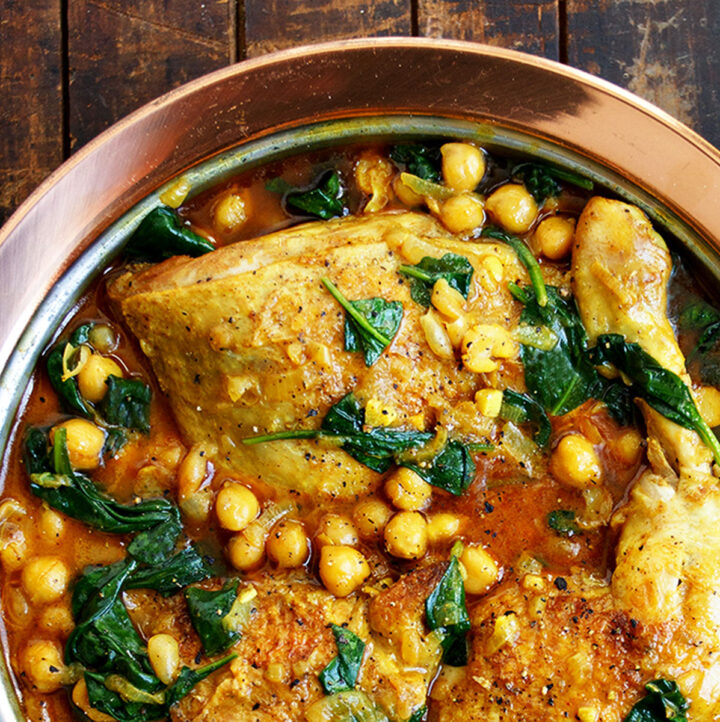 chicken chickpea curry in copper dish