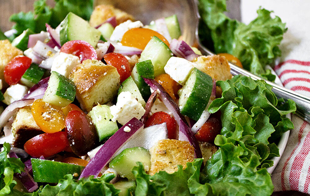 Greek panzanella salad with lettuce garnish