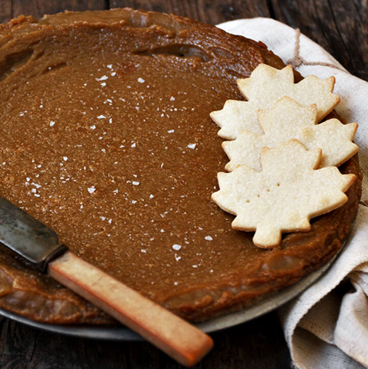 Canadian maple pie in plate with pastry maple leaves