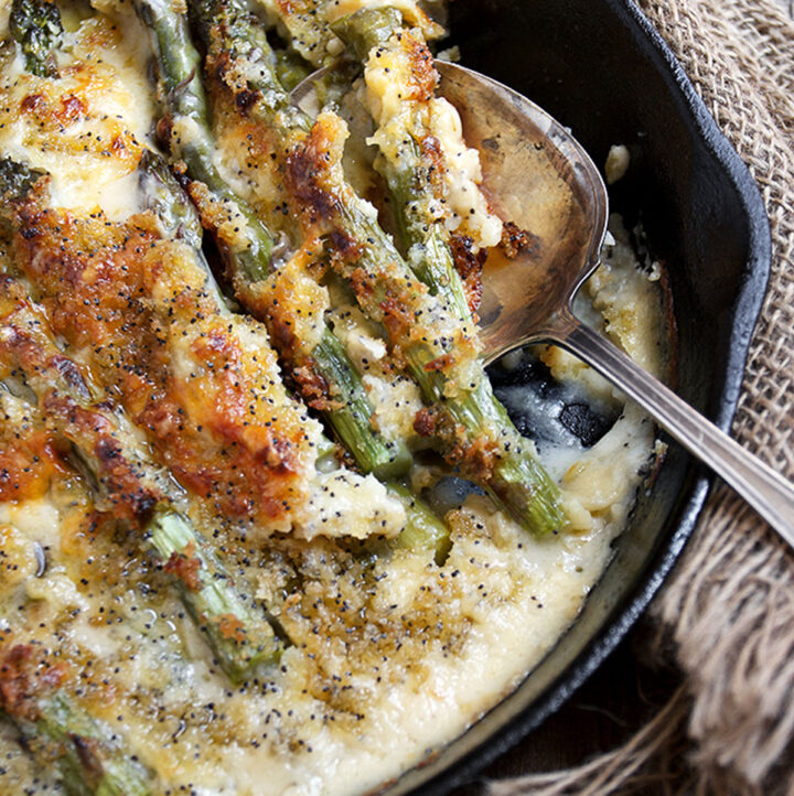 baked asparagus with cheese sauce in skillet