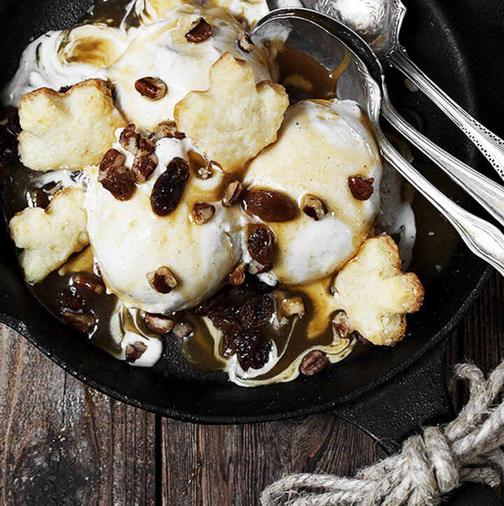 butter tart ice cream sundae in skillet with spoons