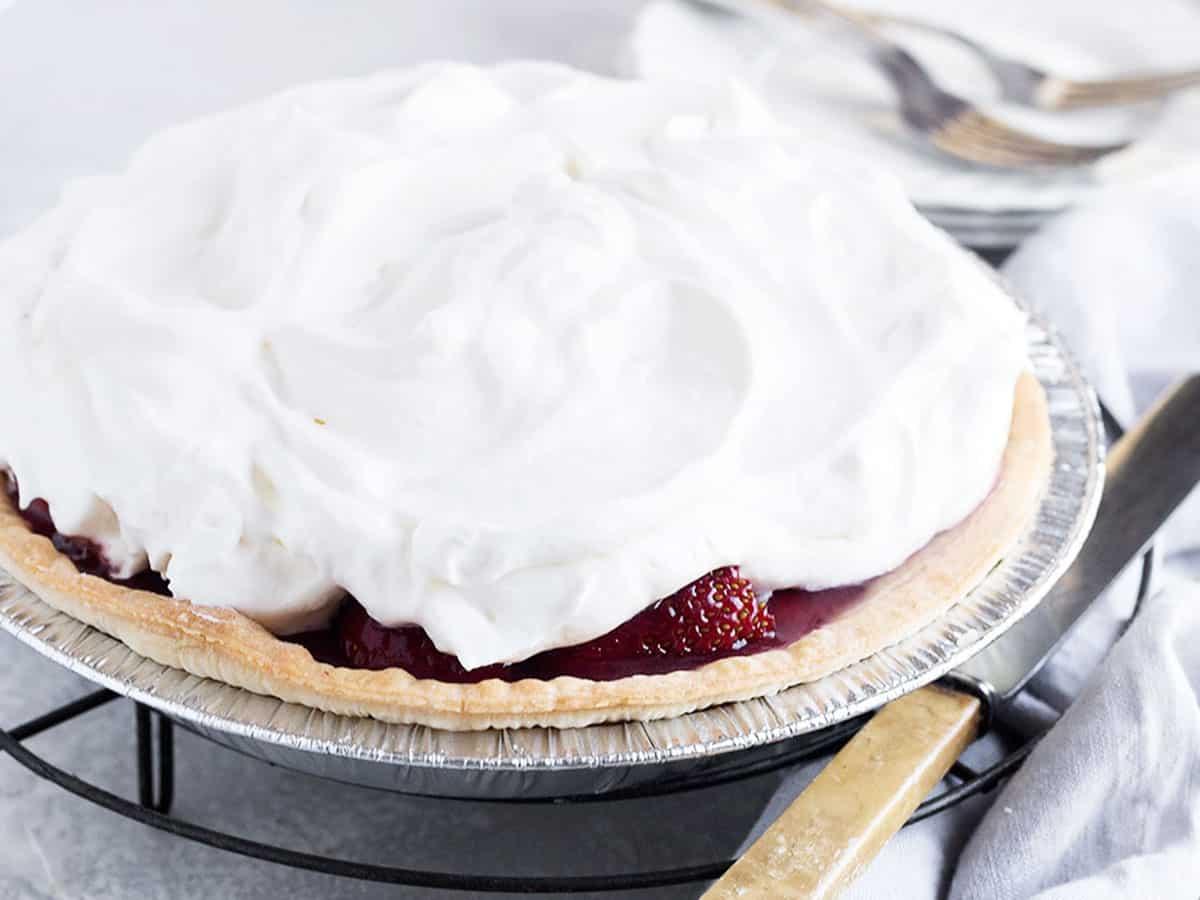 strawberry glaze pie on rack with knife