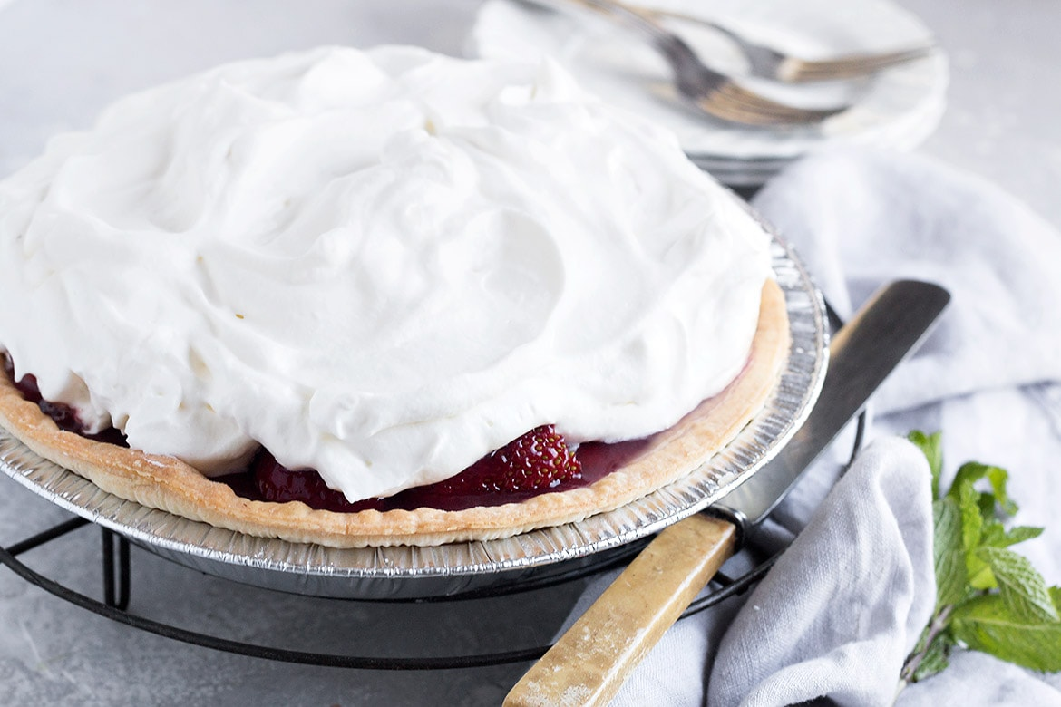fresh strawberry pie covered with whipped cream