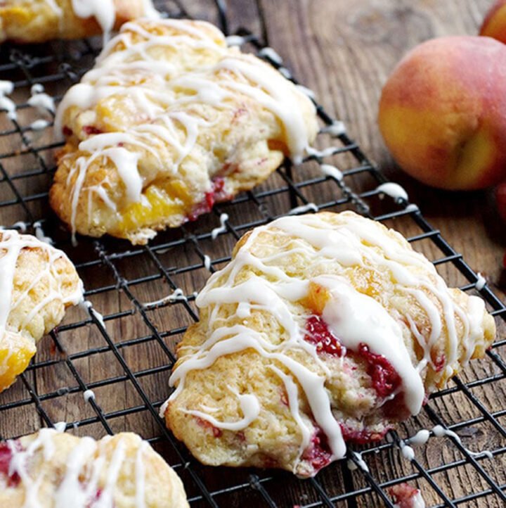 peach and raspberry scones on cooling rack