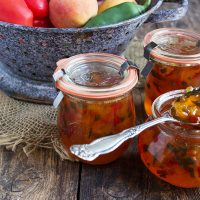 peach and pepper jams in small jars