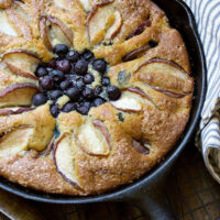 blueberry and peach cake in cast iron skillet
