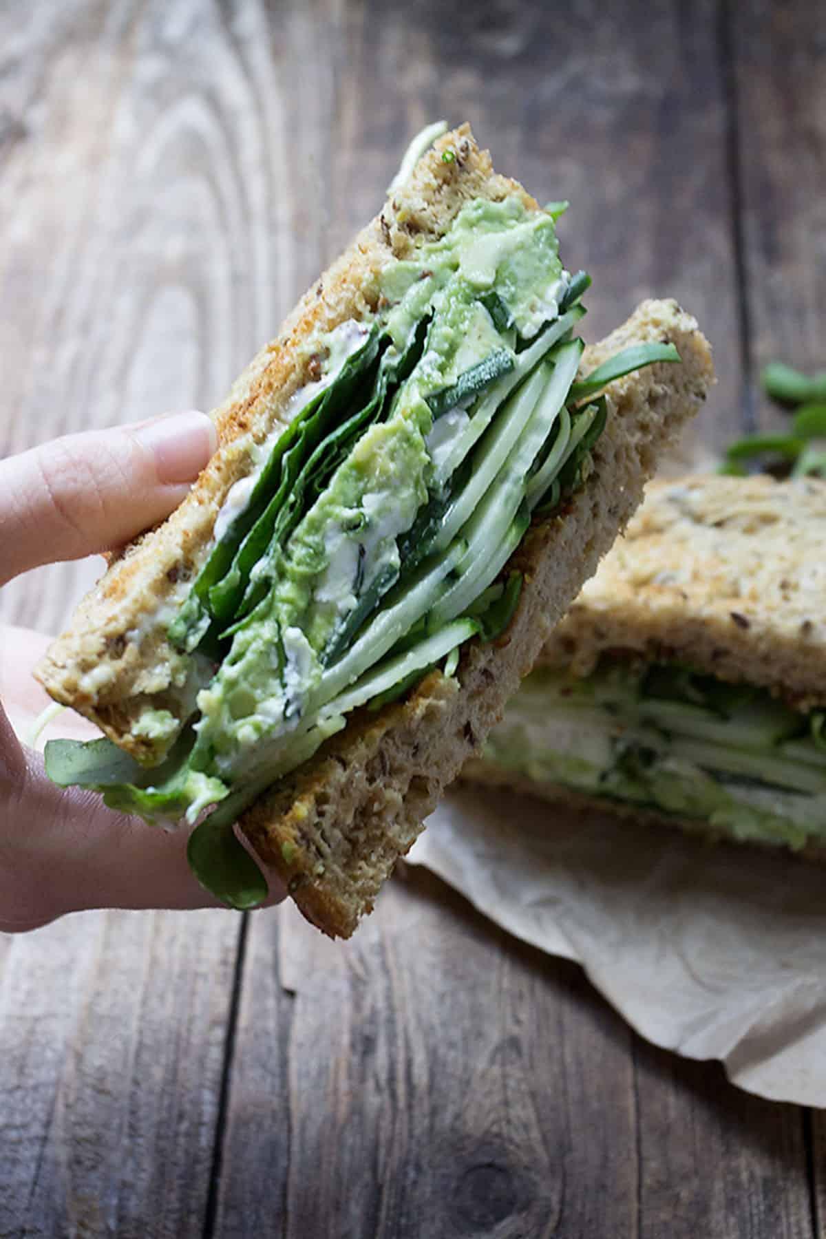 green goddess sandwich on wood background