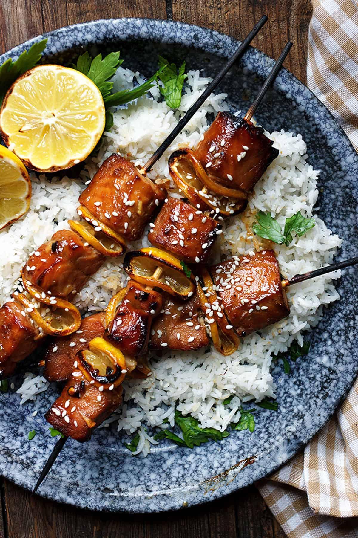 soy sesame salmon skewers on rice