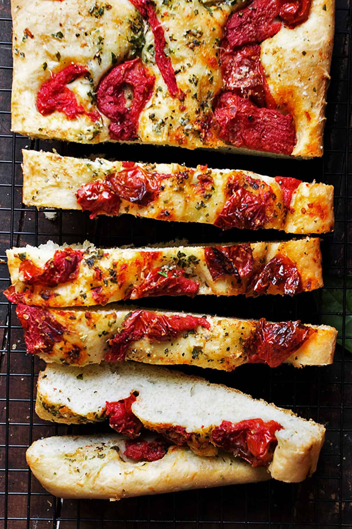 tomato focaccia sliced on cooling rack