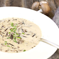 wild rice mushroom soup in white bowl