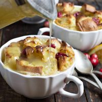 Cranberry Orange Bread Pudding with Vanilla Butter Sauce
