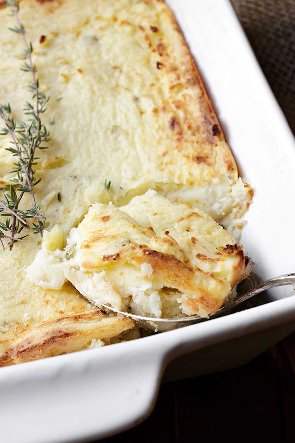 make ahead mashed potato casserole in white dish with spoon