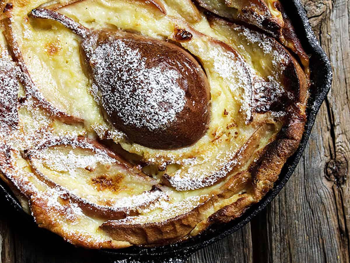 pear custard cake in small cast iron skillet
