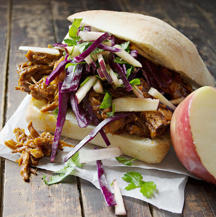 apple pulled pork sandwiches on wooden background