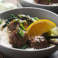 hoisin orange meatballs in bowl with rice and bok choy