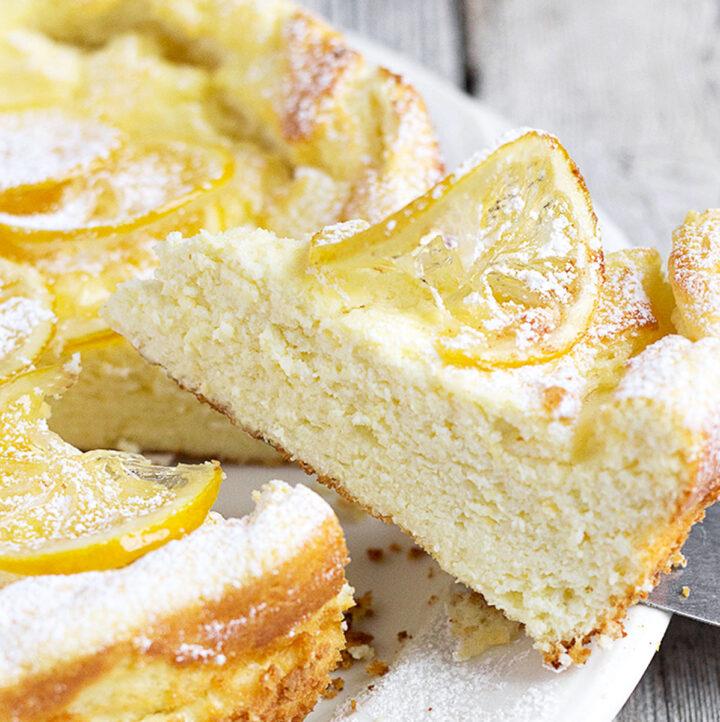 lemon ricotta cake sliced on white plate