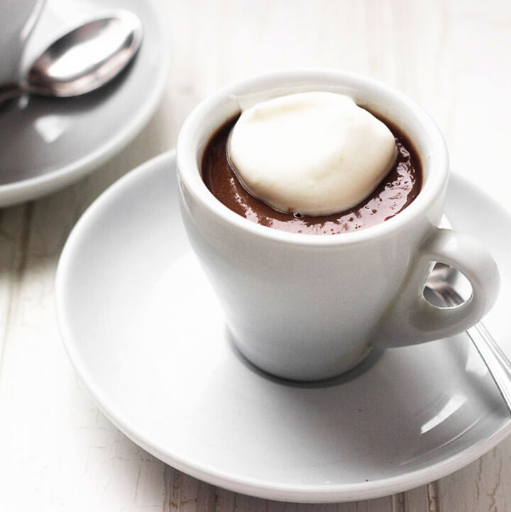 chocolate pudding shots in espresso cups with whipped cream on top