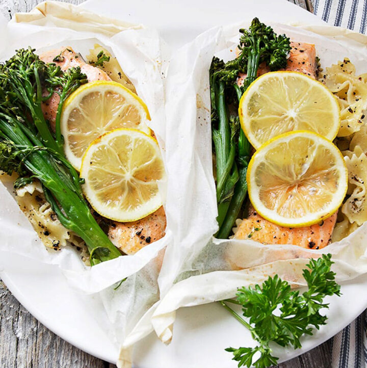 rainbow trout cooked in parchment with lemons, broccolini and pasta