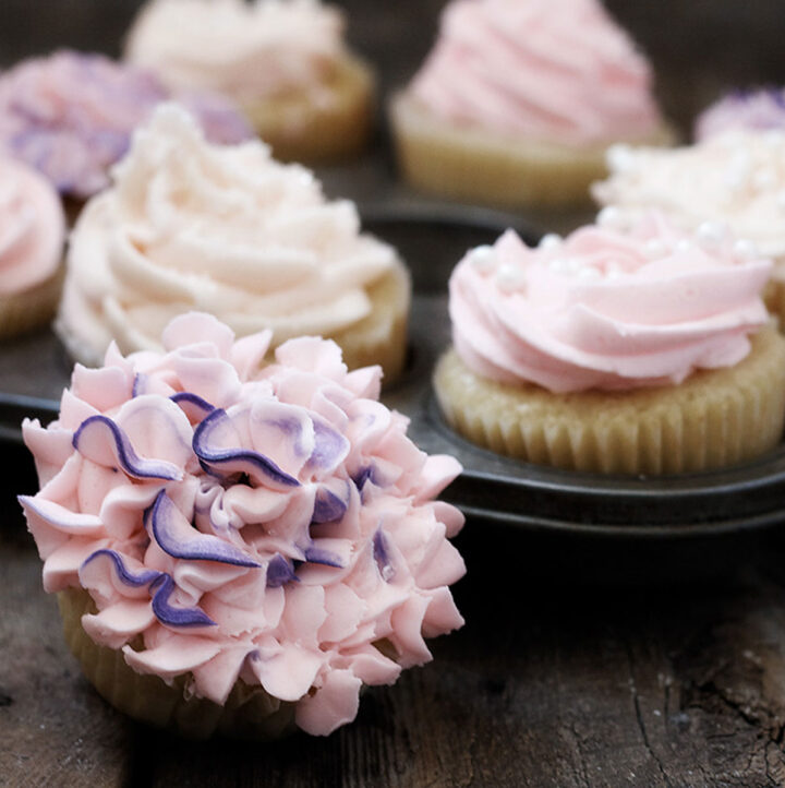 classic vanilla cupcakes with pink frosting