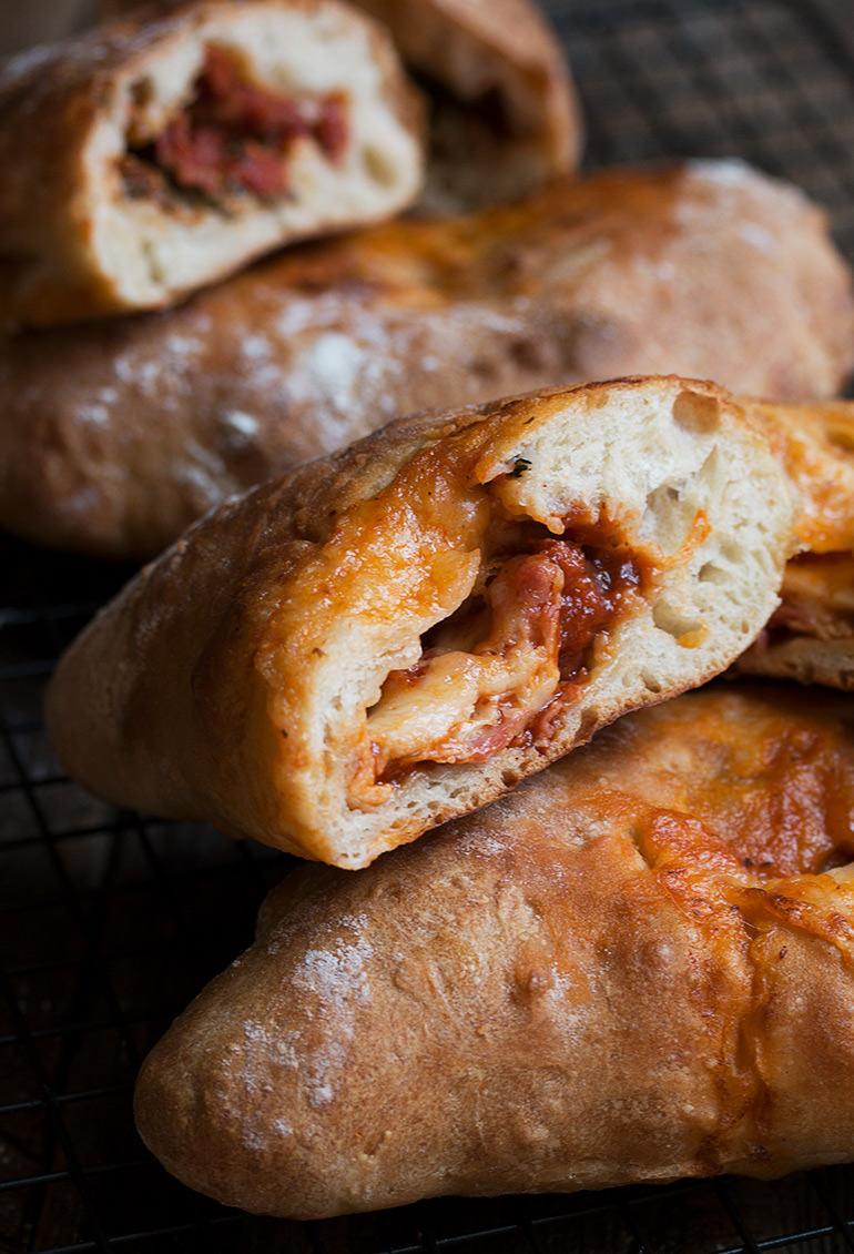 Easy Calzones: Two Ways - starts with store-bought pizza dough! With sundried tomato, pesto and bocconcini and Genoa salami, roasted red pepper and provolone versions.