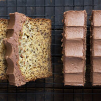 banana bread with chocolate buttercream frosting sliced