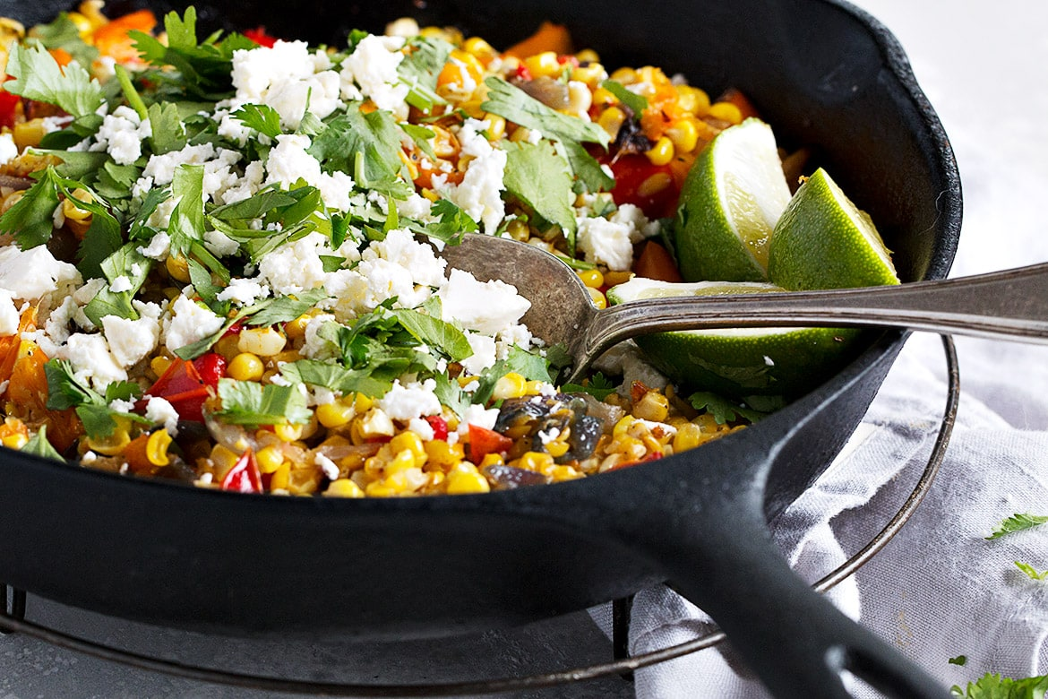 corn and pepper side dish in cast iron skillet