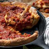 deep dish pizza in cast iron skillet