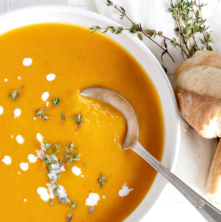 butternut squash soup in white bowl