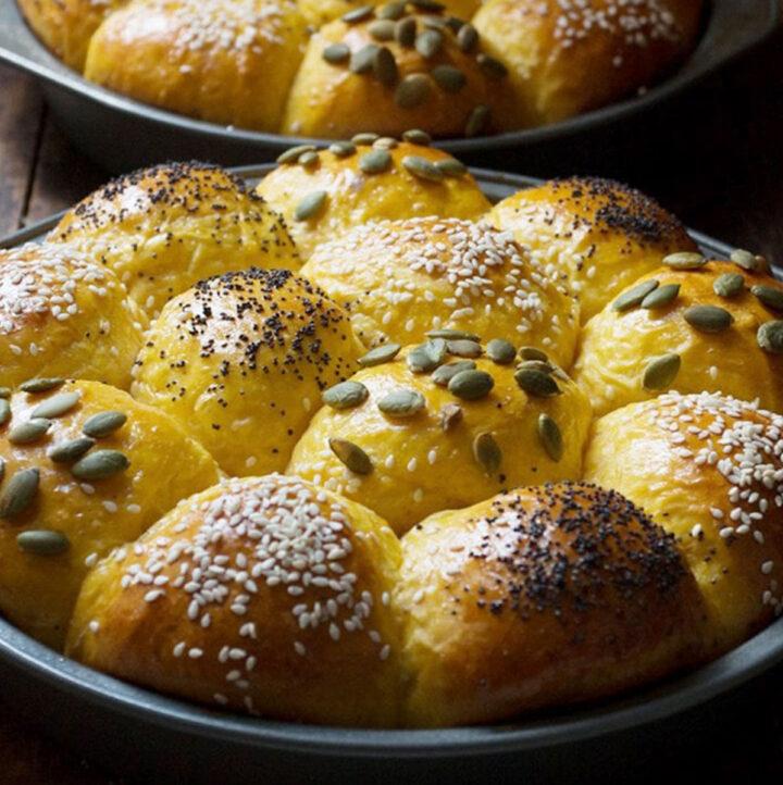 honey pumpkin rolls in baking pans