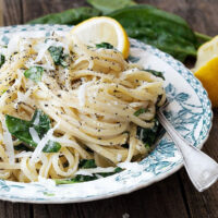 lemon pasta with spinach in bowl with fork