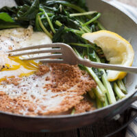parmesan fried egg in skillet with spinach
