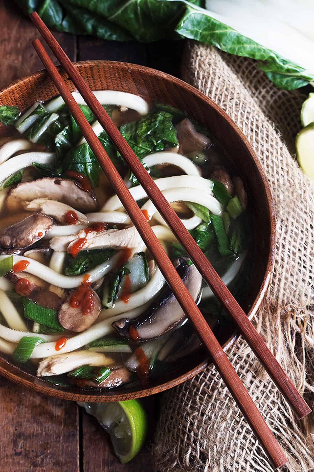 turkey noodle soup in wooden bowl with chopsticks