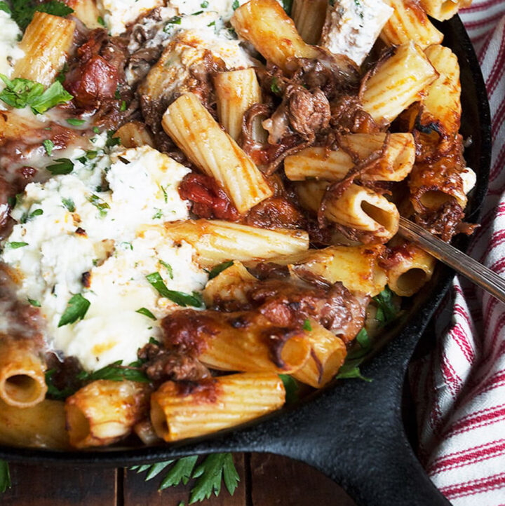 baked pasta with brisket in cast iron skillet