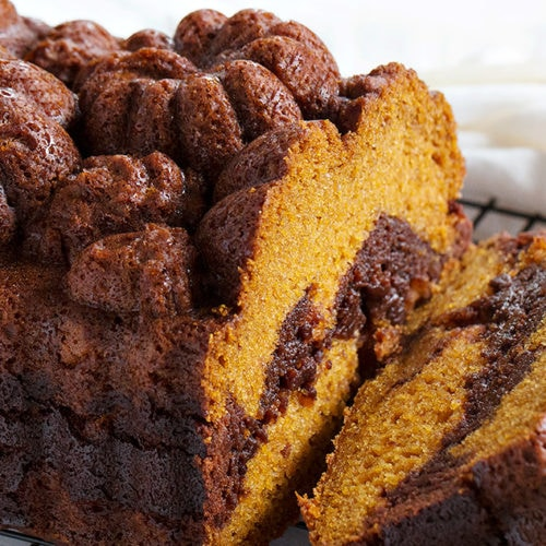 pumpkin loaf marbled with chocolate brownie on cooling rack