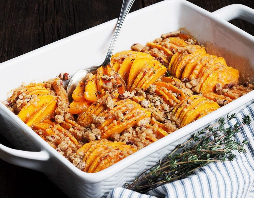 butternut squash casserole in white serving dish