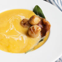 butternut soup topped with scallops and pancetta