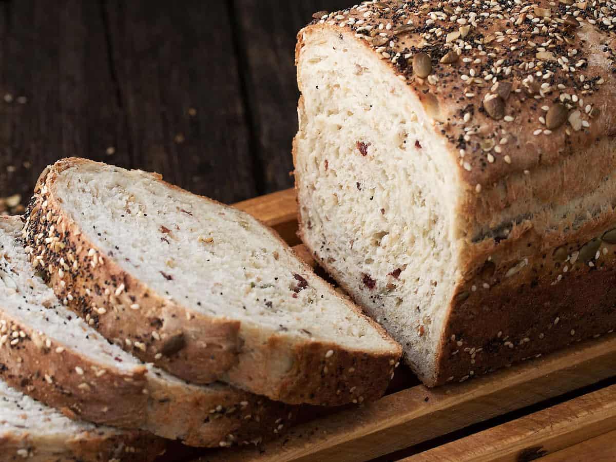 multigrain bread sliced on cutting board