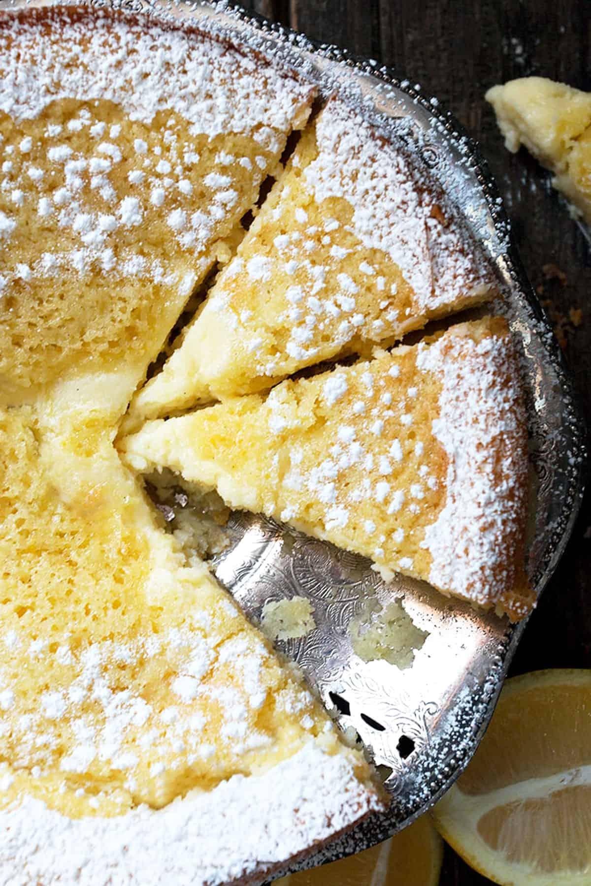 lemon cream butter cake sliced on platter