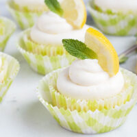 lemon cupcakes with lemon slice and mint sprig on top
