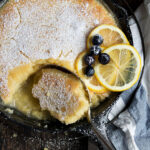 lemon cake and sauce in cast iron skillet