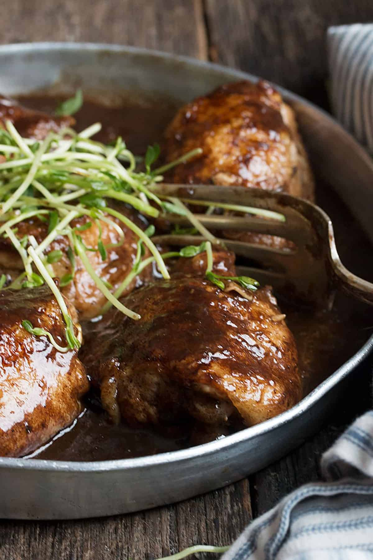 balsamic chicken in pan with fork