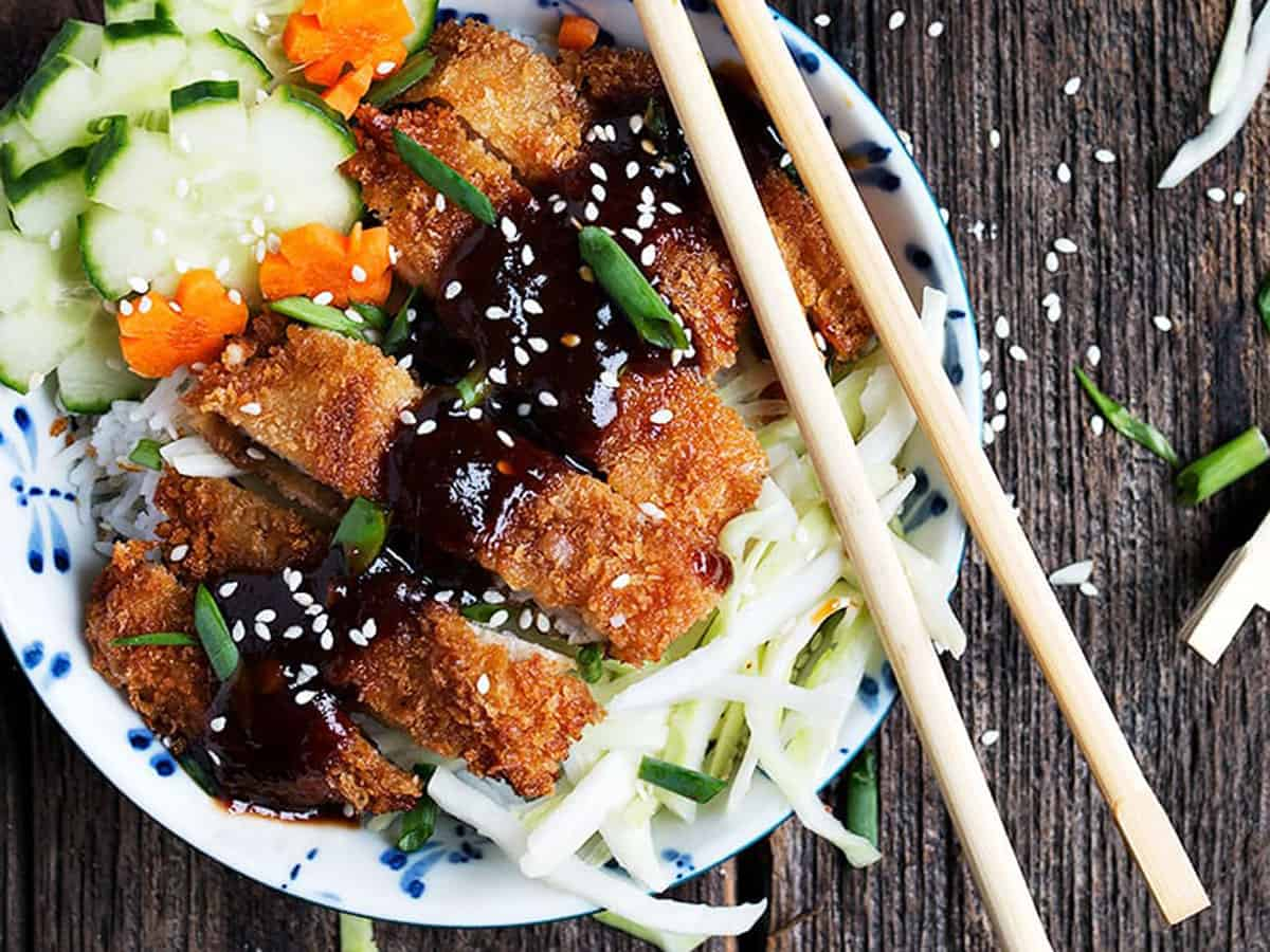 pork katsu rice bowls with chopsticks