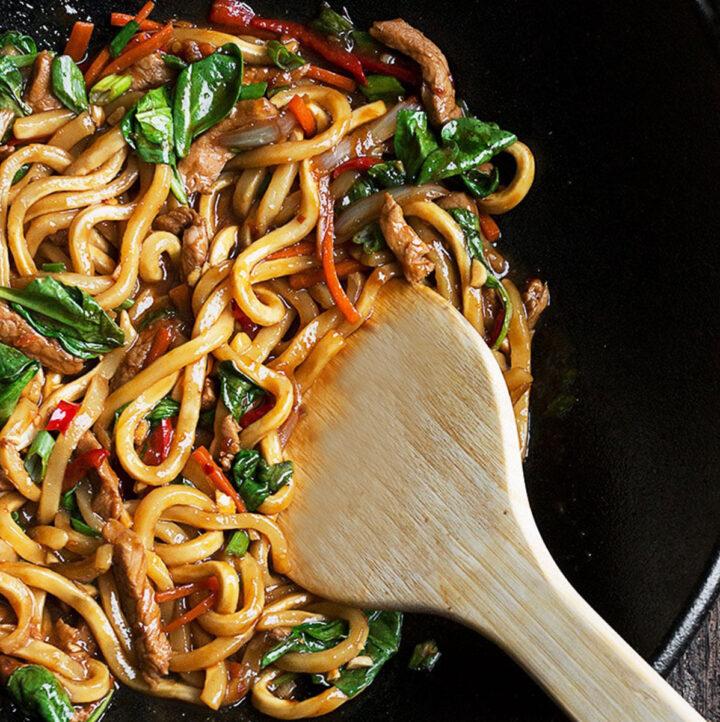 spicy pork udon in cast iron wok