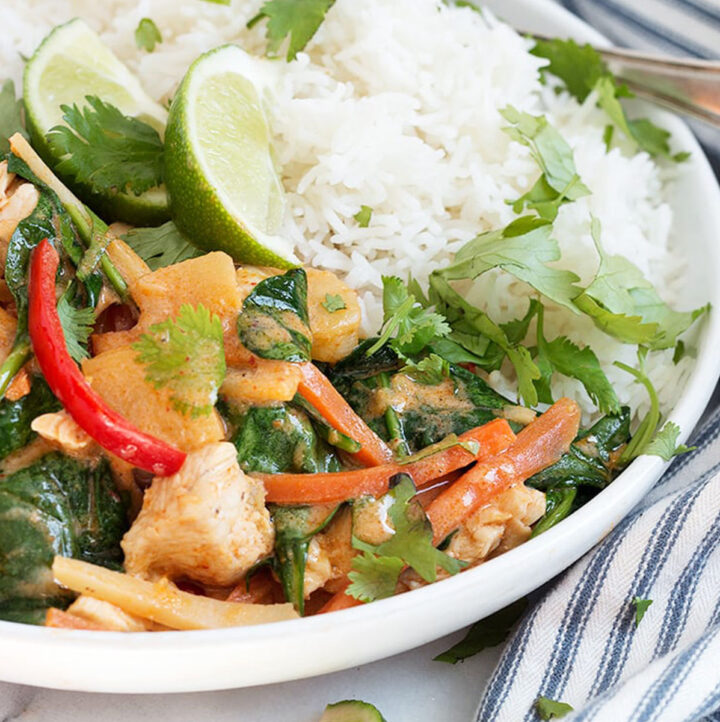 Thai red curry chicken in white bowl