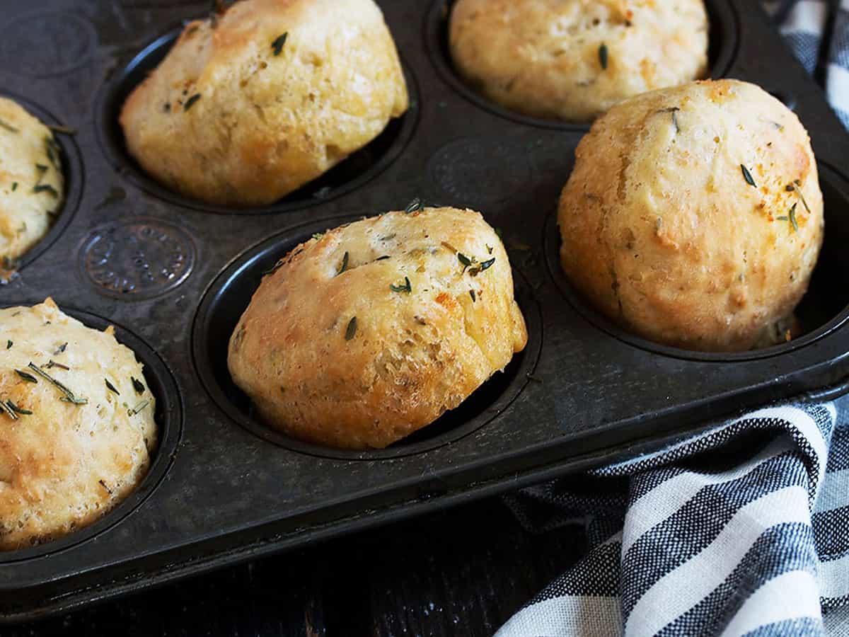 herb focaccia rolls in muffin tin