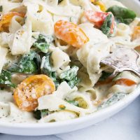 Creamy Goat Cheese Pasta with Spinach and Tomatoes